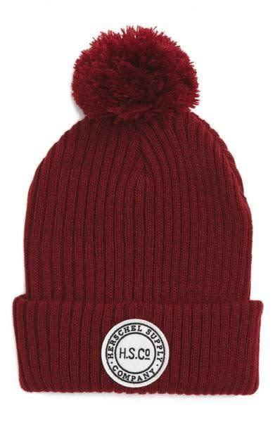 Beanies for natural hair don't have to be boring. Add some winter chic to your look with this <span>pompom beanie</span> that's got a great amount of stretch to fit over your curls.