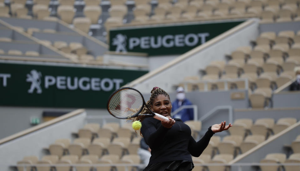 Serena Williams of the U.S. plays a shot against Kristie Ahn of the U.S. in a near-empty center court Philippe Chatrier in the first round match of the French Open tennis tournament at the Roland Garros stadium in Paris, France, Monday, Sept. 28, 2020. (AP Photo/Alessandra Tarantino)