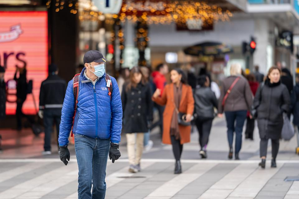 STOCKHOLM, Nov. 3, 2020 -- A man wearing a face mask walks in the street during the COVID-19 pandemic in Stockholm, capital of Sweden, on Nov. 3, 2020. (Photo by Wei Xuechao/Xinhua via Getty) (Xinhua/Wei Xuechao via Getty Images)