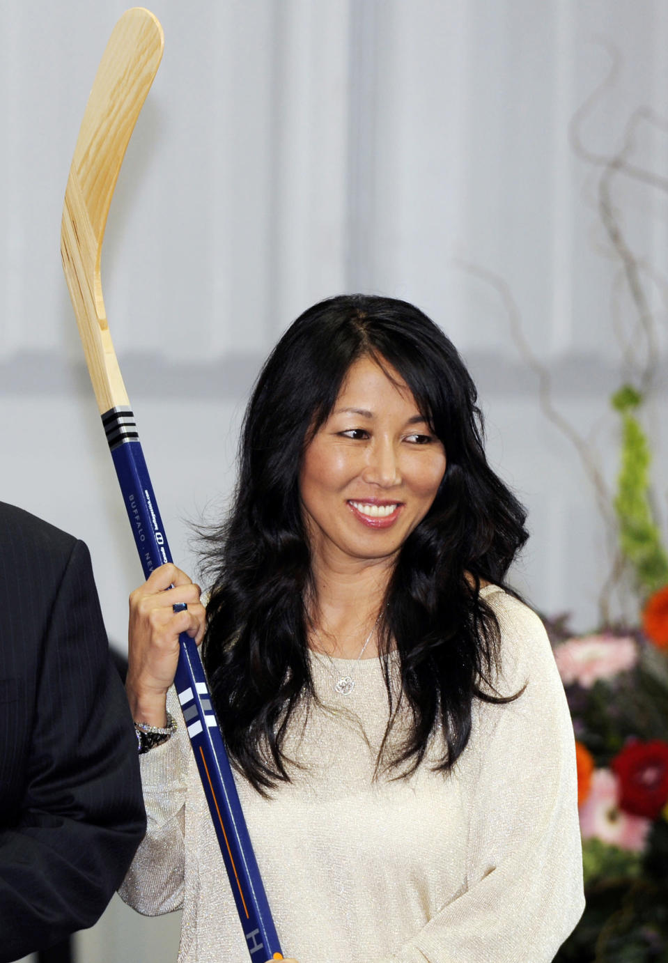 FILE - In this April 13, 2013, file photo, Kim Pegula poses during groundbreaking ceremonies at First Niagara Center in Buffalo, N.Y. The NHL is finally shrugging off its reputation as being a 'men-only club with the Maple Leafs hiring Hayley Wickenheiser to a player development role, and Kim Pegula taking over as president of the Buffalo Sabres. (AP Photo/Gary Wiepert, File)