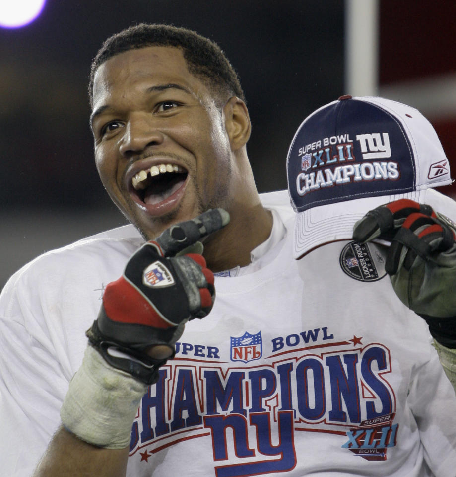 FILE - In this Feb. 3, 2008 file photo, New York Giants defensive end Michael Strahan celebrates after the Giants beat the New England Patriots 17-14 in the Super Bowl XLII football game in Glendale, Ariz. Single-season sacks leader Strahan and two players who tried to block him are among 15 modern-era finalists for the Pro Football Hall of Fame, the hall announced Friday, Jan. 11, 2013. (AP Photo/David J. Phillip, File)