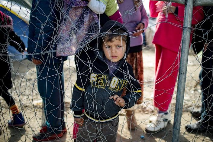 A boy stands in queue for food at a makeshift camp at the Greek-Macedonian border near the village of Idomeni on March 21, 2016 (AFP Photo/Andrej Isakovic)