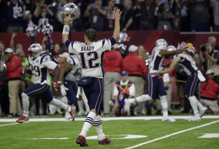 "<a class=""link rapid-noclick-resp"" href=""/nfl/players/5228/"" data-ylk=""slk:Tom Brady"">Tom Brady</a> and the Patriots celebrate after winning Super Bowl LI in overtime. (AP)"