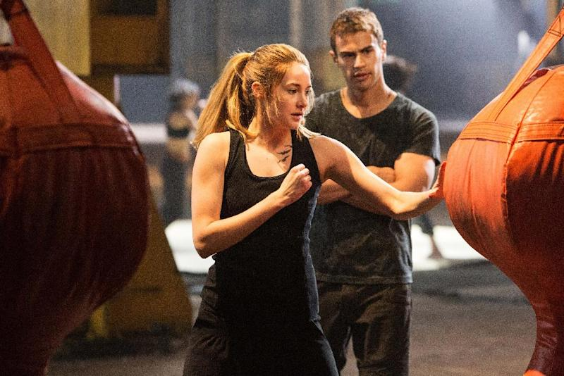"This photo released by Summit Entertainment, LLC shows Shailene Woodley as Beatrice ""Tris"" Prior, left, and Theo James as Four, in the film, ""Divergent."" (AP Photo/Summit Entertainment, Jaap Buitendijk)"