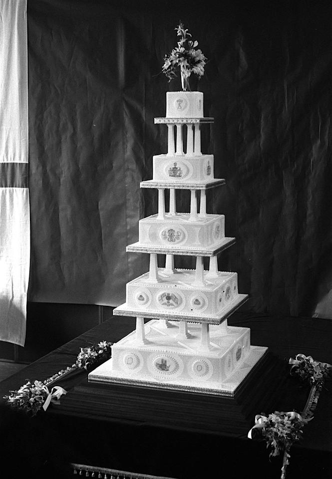 <p>Prince Andrew and Duchess Fergie served guests at their July 1986 wedding with a five-foot marzipan and rum cake. The five-tier bake was prepared at the navy supply school HMS Raleigh. <em>[Photo: Getty]</em> </p>