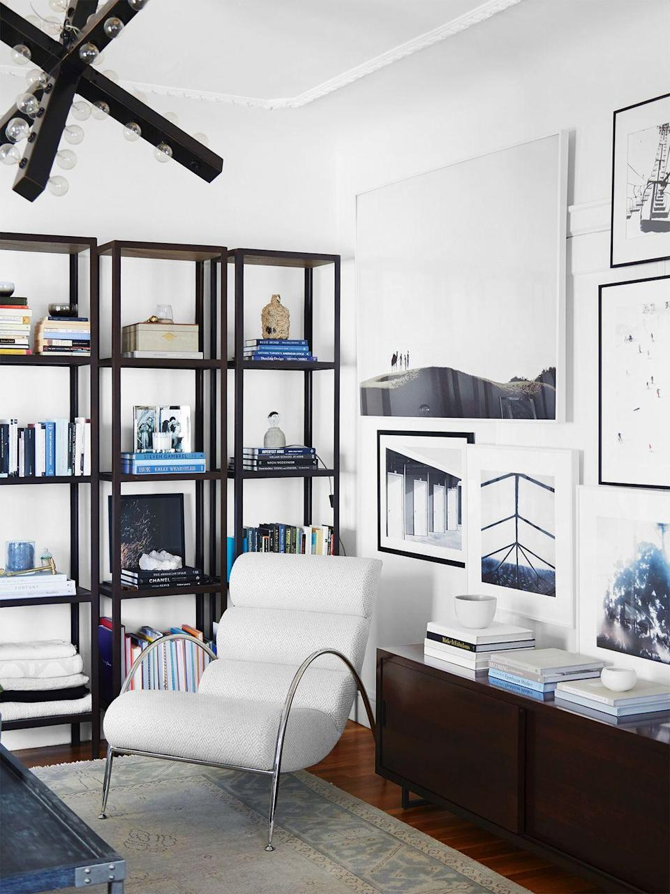 <p>Choosing metal shelves with an open framework is an easy way to free up visual space in your library. </p>