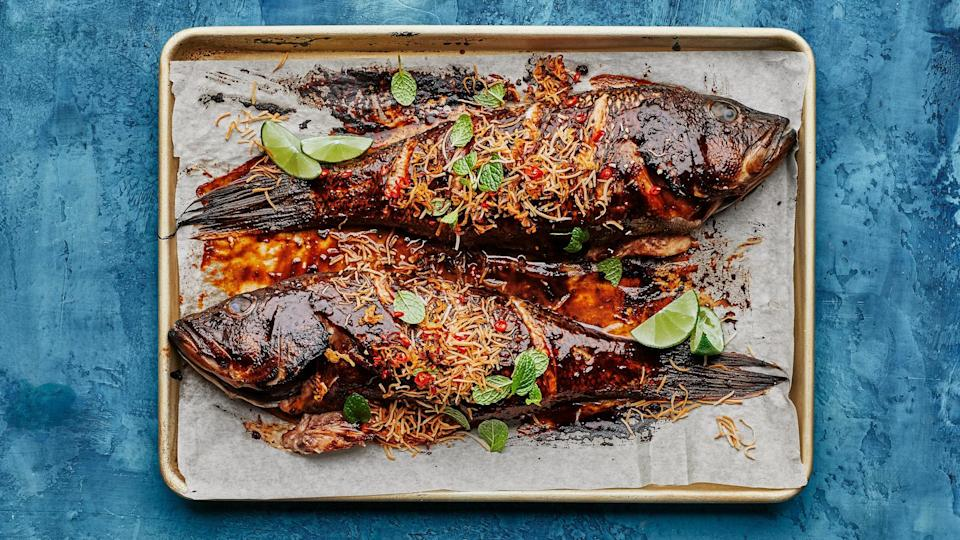 In this recipe, tamarind concentrate is incorporated into a glaze that's slathered over black bass.