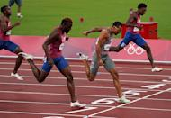 Andre De Grasse, of Canada, races to win the gold medal ahead of Kenneth Bednarek, foreground, of the United States, silver, and Noah Lyles, right, of the United States, bronze, in the final of the men's 200-meters at the 2020 Summer Olympics, Wednesday, Aug. 4, 2021, in Tokyo, Japan. (Nathan Denette/The Canadian Press via AP)