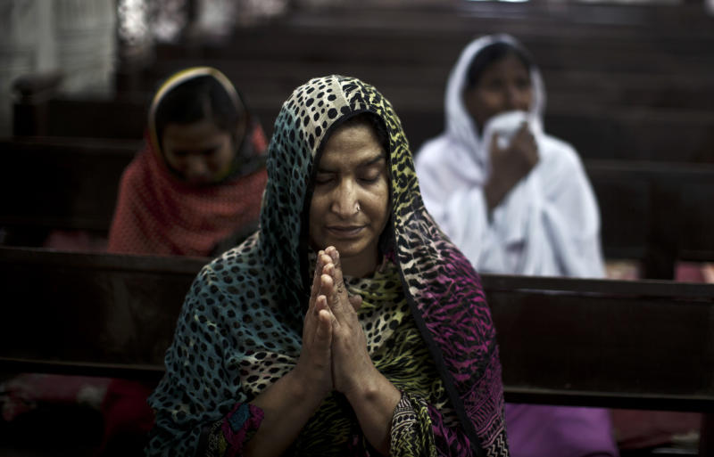 In this Monday, Sept. 23, 2013, photo, Pakistani Christian worshippers, some of them who survived Sunday's suicide bombing, pray during a special mass for the victims of the bombing, at the Church where the attack took place, in Peshawar, Pakistan. A Sunni militant group known for targeting rival Muslims has emerged as a dangerous new player in Pakistan, sending a pair of suicide bombers to stage the deadliest ever attack against Pakistani Christians. The brutal assault, killed tens of worshippers on Sunday, Sept. 22, 2013. (AP Photo/Muhammed Muheisen)