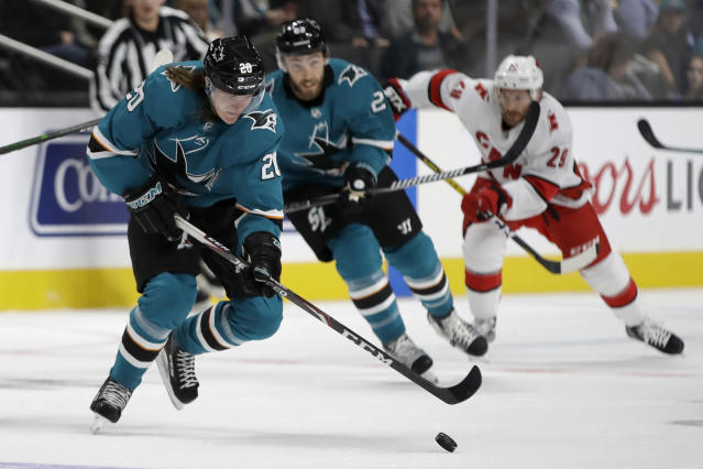 San Jose Sharks' Marcus Sorensen, left, moves the puck during the first period of the team's NHL hockey game against the Carolina Hurricanes on Wednesday, Oct. 16, 2019, in San Jose, Calif. (AP Photo/Ben Margot)