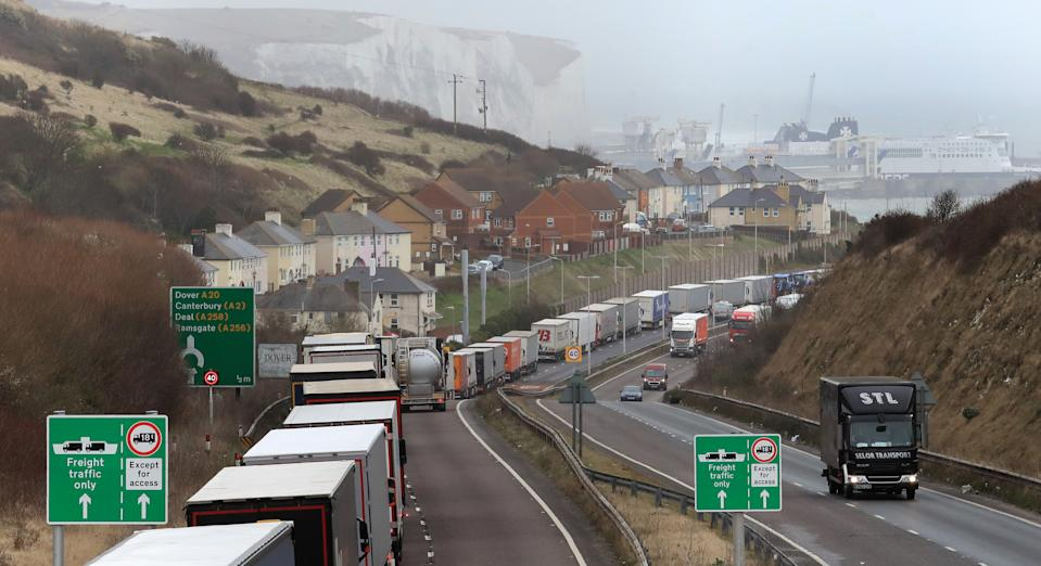 Lorries queue at the entrance to the Port of Dover in Kent as bad weather causes cross Channel ferry delays. (Photo by Gareth Fuller/PA Images via Getty Images)