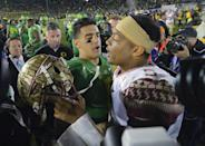 Oregon quarterback Marcus Mariota, center left, greets Florida State quarterback Jameis Winston after Oregon's win in the Rose Bowl NCAA college football playoff semifinal, Thursday, Jan. 1, 2015, in Pasadena, Calif. (AP Photo/Mark J. Terrill)
