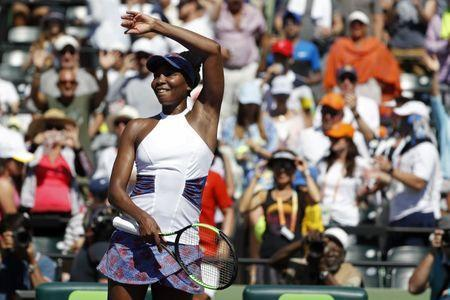 Mar 25, 2018; Key Biscayne, FL, USA; Venus Williams of the United States waves to the crowd after her match against Kiki Bertens of the Netherlands (not pictured) on day six of the Miami Open at Tennis Center at Crandon Park. Williams won 5-7, 6-3, 7-5. Geoff Burke-USA TODAY Sports