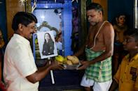 Villagers took bananas and coconuts to the village temple