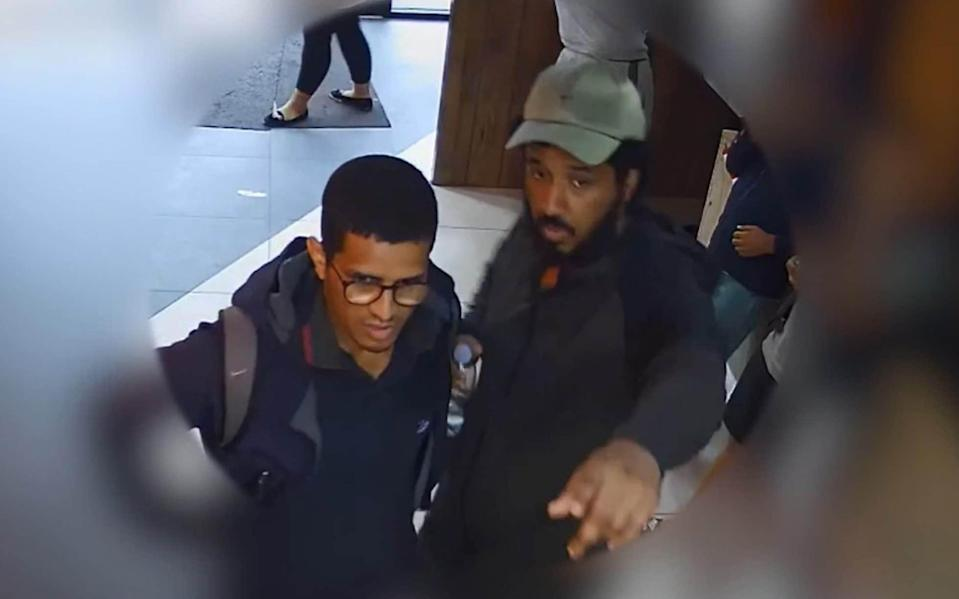 CCTV issued by the Metropolitan Police showing Sahayb Abu, 27 and Muhamed Abu, 32, in a fast food restaurant - PA