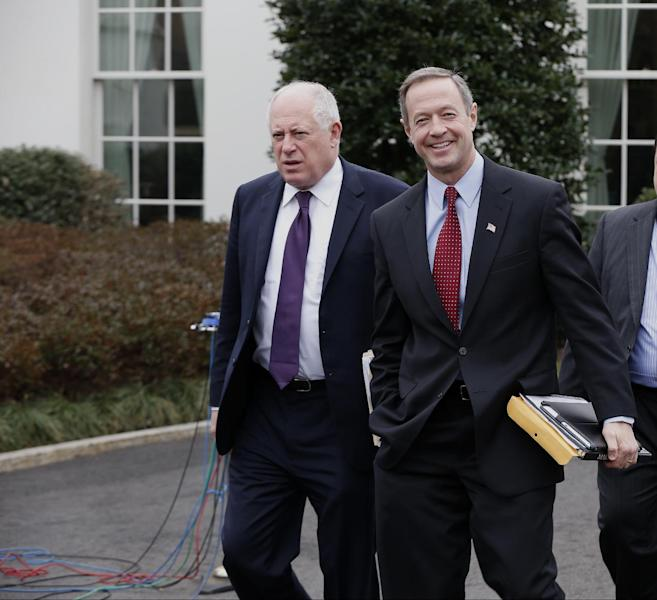 Maryland Gov. Martin O'Malley, right, and Illinois Gov. Pat Quinn walk outside the White House in Washington, Friday, Feb. 21, 2014, before their meeting with President Barack Obama. (AP Photo/Charles Dharapak)