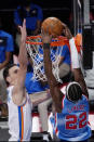 Oklahoma City Thunder forward Aleksej Pokusevski (17) defends Brooklyn Nets guard Caris LeVert (22) as LeVert scores during the second half of an NBA basketball game Sunday, Jan. 10, 2021, in New York. (AP Photo/Kathy Willens)