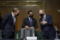 FireEye CEO Kevin Mandia, SolarWinds CEO Sudhakar Ramakrishna and Microsoft President Brad Smith talk before a Senate Intelligence Committee hearing on Capitol Hill on Tuesday, Feb. 23, 2021 in Washington. (Drew Angerer/Photo via AP)