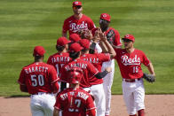 Cincinnati Reds' teammates celebrate after defeating the Pittsburgh Pirates 11-4 at Great American Ball Park in Cincinnati, Wednesday, April 7, 2021. (AP Photo/Bryan Woolston)