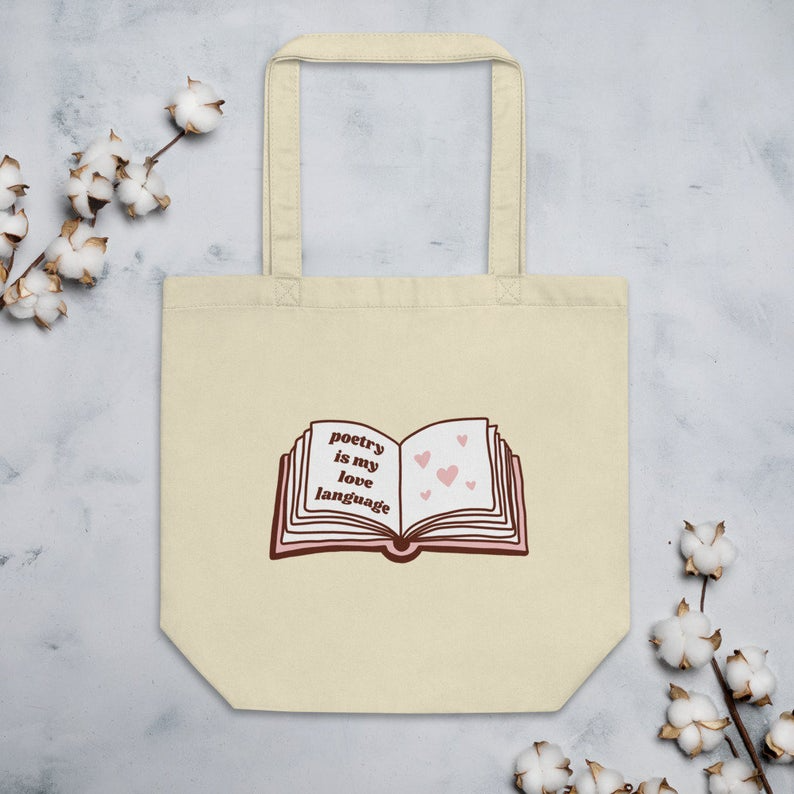 """<h2>Poetry Is My Love Language Eco-Friendly Tote</h2><br>With this bag, you can carry all your books and let people know that you whole-heartedly support the art of self-expression. <br><br><em>Shop</em> <strong><em><a href=""""https://www.etsy.com/shop/TristaMateerShop"""" rel=""""nofollow noopener"""" target=""""_blank"""" data-ylk=""""slk:Trista Mateer"""" class=""""link rapid-noclick-resp"""">Trista Mateer</a></em></strong><br><br><br><br><strong>A.P.C</strong> Poetic Persistence Indigo Denim Tote Bag, $, available at <a href=""""https://go.skimresources.com/?id=30283X879131&url=https%3A%2F%2Ffave.co%2F2T9aHSL"""" rel=""""nofollow noopener"""" target=""""_blank"""" data-ylk=""""slk:Garmentory"""" class=""""link rapid-noclick-resp"""">Garmentory</a>"""