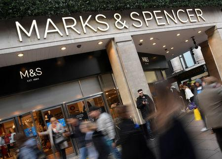 FILE PHOTO - Shoppers walk past a branch of Marks and Spencer in central London, Britain, November 3, 2017. Picture taken November 3, 2017. REUTERS/Toby Melville