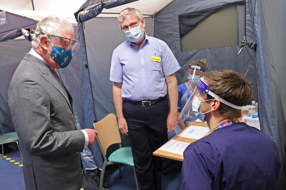 GLOUCESTER, ENGLAND - DECEMBER 17: Prince Charles, Prince of Wales wears a face-mask and protective glasses while speaking with NHS staff involved in the vaccination programme during a visit to Gloucestershire Vaccination Centre at Gloucestershire Royal Hospital on December 17, 2020 in Gloucester, England. Gloucestershire Hospitals NHS Foundation Trust is one of the largest non-specialist Trust's in England, The Trust is the designated Management and Coordination Centre for the roll out of the COVID-19 Vaccination Programme for Gloucestershire. Their Royal Highnesses The Prince of Wales and The Duchess of Cornwall previously visited Gloucestershire Royal Hospital in June of this year, the first engagement outside of a Royal residence by any Member of the Royal Family following the first national lockdown. (Photo by Chris Jackson/Getty Images)
