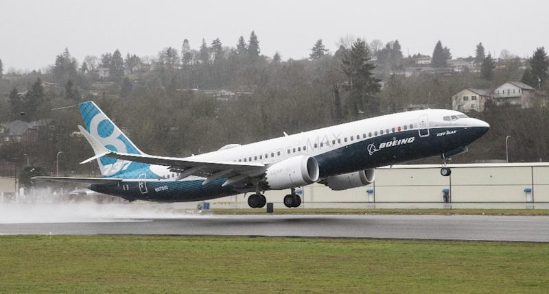 A Boeing 737 MAX 8 is seen here taking off for a test flight on January 29, 2016 in Renton, Washington -- the plane entered commercial service in 2017 (AFP Photo/STEPHEN BRASHEAR)