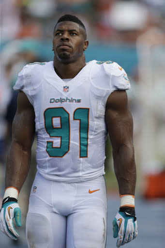 Miami Dolphins defensive end Cameron Wake (91) on the sidelines during the first half of an NFL football game against the Atlanta Falcons, Sunday, Sept. 22, 2013, in Miami Gardens, Fla. (AP Photo/Wilfredo Lee)