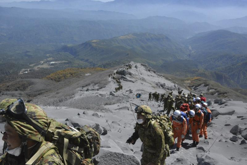 Japan Self-Defense Force (JSDF) soldiers and firefighters climb up Mt. Ontake, which straddles Nagano and Gifu prefectures, for a rescue operation