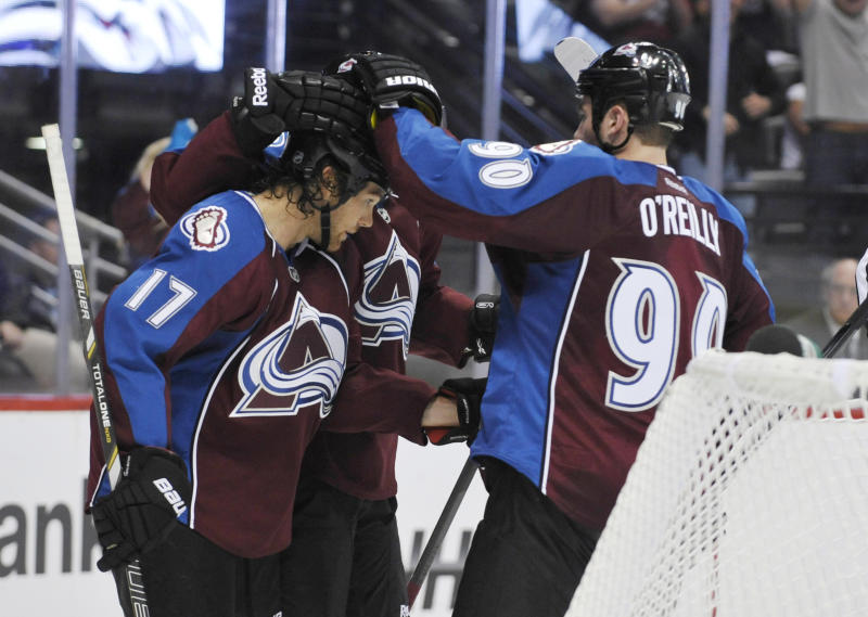Colorado Avalanche right wing Steve Downie (17) is congratulated by teammates Ryan O'Reilly (90) and Matt Duchene after scoring a goal against the Los Angeles Kings during the third period of a preseason NHL hockey game on Friday, Sept. 20, 2013, in Denver. (AP Photo/Jack Dempsey)