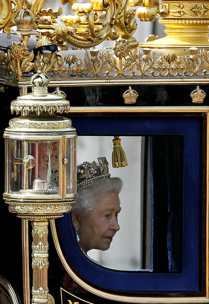 FILE This Tuesday, May 25, 2010 file photo shows Britain's Queen Elizabeth II returning to Buckingham Palace in a carriage after attending the Houses of Parliament in London for the official State Opening of Parliament. The patriotic bunting is ready, the golden carriage on standby, the boats freshly painted, the shops filled with royals souvenirs. The normal ebb and flow of British life gives way in the next four days to a series of street parties, flotillas, outdoor concerts and finally the appearance of an elderly great-grandmother on her balcony to wave to her subjects.The pageantry is very grand and very British. But at the heart of the Diamond Jubilee celebration is a nearly universal sense of appreciation for the reign of Queen Elizabeth II, who is marking 60 years on the throne. (AP Photo/Kirsty Wigglesworth)