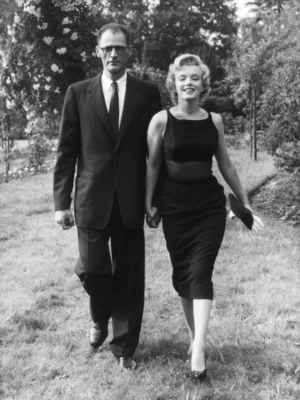 "<p>Monroe had an affair with playwright Arthur Miller, who <a href=""http://people.com/celebrity/read-marilyn-monroes-very-racy-love-letter-from-arthur-miller/"" rel=""nofollow noopener"" target=""_blank"" data-ylk=""slk:wrote her lustful letters"" class=""link rapid-noclick-resp"">wrote her lustful letters</a> during her marriage to Joe DiMaggio. She filed for divorce from DiMaggio in 1954 and he wrote her his own letter, begging her to come back. Monroe eventually married Miller. </p>"