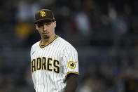 San Diego Padres' Blake Snell walks toward the dugout during the fifth inning of a baseball game against the San Francisco Giants, Saturday, May 1, 2021, in San Diego. (AP Photo/Gregory Bull)