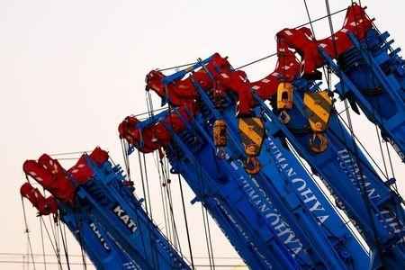 Cranes are parked in a company compound in Tokyo