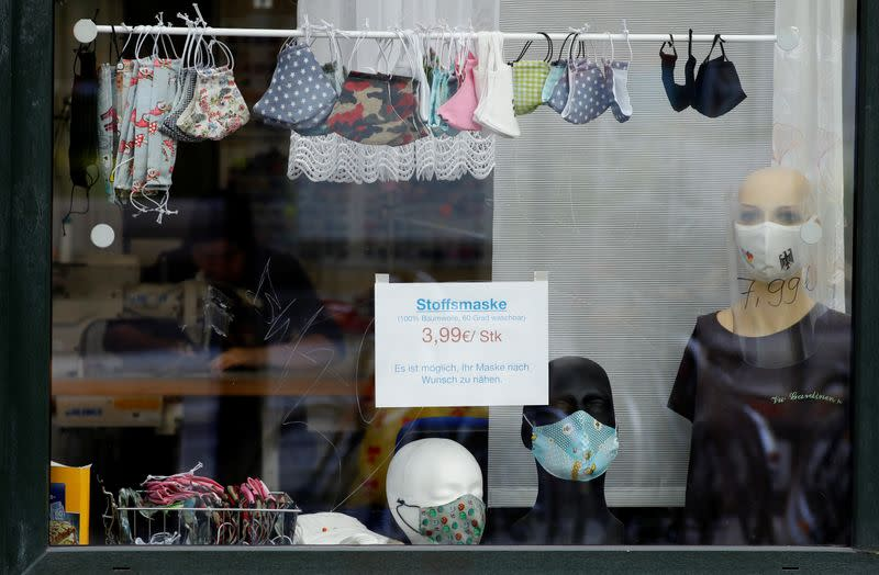 Protective masks are pictured on the window of a tailoring shop, amid the coronavirus disease (COVID-19) outbreak, in Halle