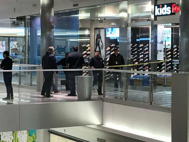 Man arrested after boy falls from balcony at U.S.  shopping centre