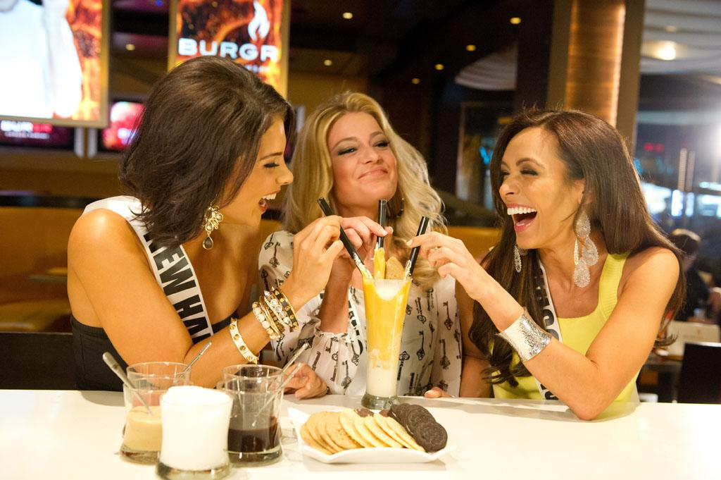 Miss New Hampshire USA 2013, Amber Faucher; Miss Wyoming USA 2013, Courtney Gifford; and Miss Wisconsin USA 2013, Chrissy Zamora; taste the pudding milkshake they made at BurGR in Las Vegas, Nevada on Wednesday June 5, 2013.