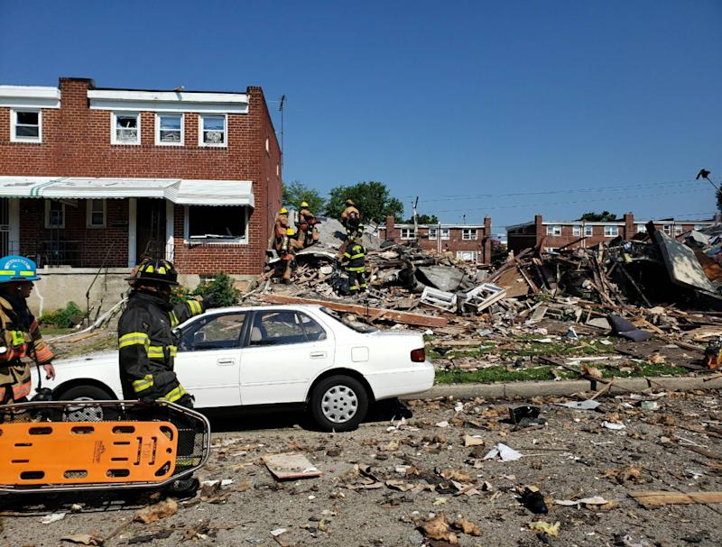 Firefighters respond to a major gas explosion that destroyed three homes in a Baltimore neighbourhood: Baltimore County Fire Department