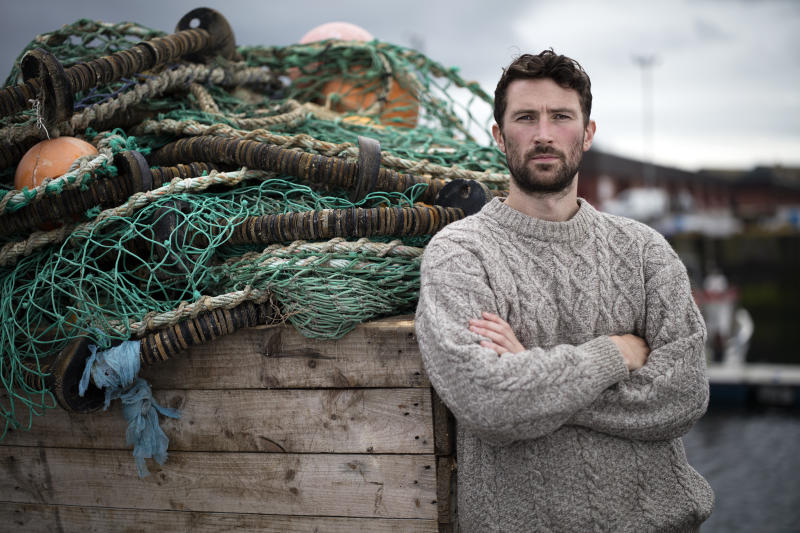 Rugged Scottish fisherman with his arms folded