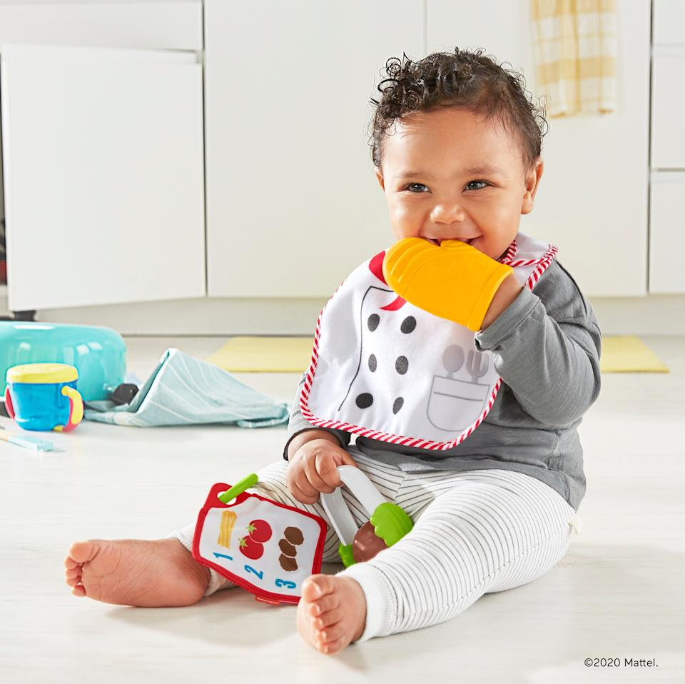 The New Fisher-Price Cutest ChefGift Set ($14.99, available now) has a chef's apron bib, chewable oven mitt, tongs with a spinning meatball, and a recipe card.
