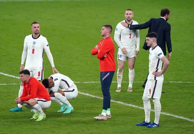Southgate and his players were left dejected after losing the shoot-out.