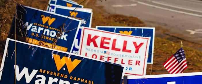 Lawrenceville, Georgia | United States - December 22 2020: Georgia Senate runoff election signs along the side of the road near a polling location