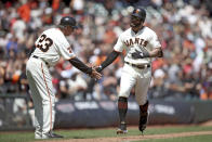 San Francisco Giants' Kevin Pillar (1) is congratulated by third base coach Ron Wotus after hitting a solo home run during the fifth inning of the team's baseball game against the Philadelphia Phillies in San Francisco, Saturday, Aug. 10, 2019. (AP Photo/Scot Tucker)