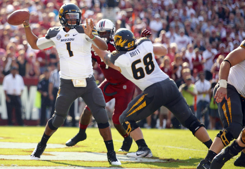 Missouri quarterback James Franklin drops back to pass during the first half of an NCAA college football game against South Carolina at Williams-Brice Stadium in Columbia, S.C., Saturday, Sept. 22, 2012. (AP Photo/Brett Flashnick)