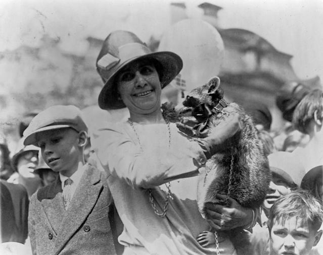 <p>First Lady Grace Coolidge holds her pet raccoon, Rebecca, for a crowd of children at the annual White House Easter Egg Roll in Washington, April 18, 1927. </p>