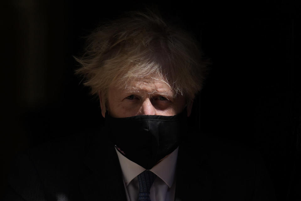 British Prime Minister Boris Johnson leaves 10 Downing Street to attend the weekly Prime Minister's Questions at the Houses of Parliament, in London, Wednesday, June 23, 2021. (AP Photo/Matt Dunham)