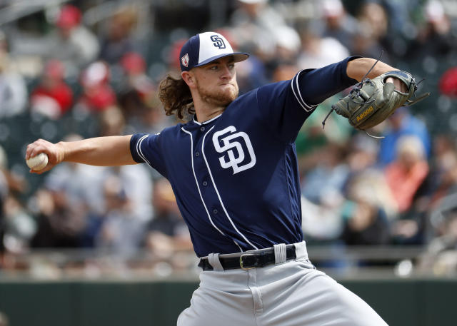 FILE - In this March 8, 2019, file photo, San Diego Padres pitcher Chris Paddack throws against the Oakland Athletics during the first inning of a spring training baseball game, in Mesa, Ariz. The 23-year-old Paddack, a promising right-hander, will be part of San Diegos rotation when the regular season begins. (AP Photo/Matt York, File)