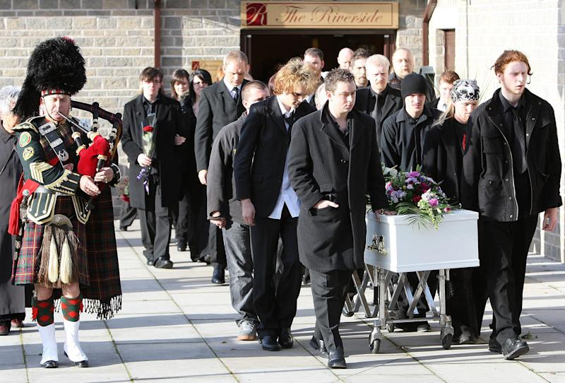 Mourners walk alongside the coffin of Sophie Lancaster, who was kicked to death in a park, following her humanist funeral at the Riverside Centre in Whitworth, Lancashire.