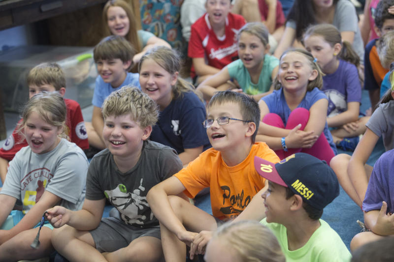 SOUTH PORTLAND, ME - JULY 11: Campers laugh while watching a short, theatric marine science demonstration at Fish Camp in South Portland. The husband and wife team of Jeff and Deb Sandler, better known as Mr. and Mrs. Fish, have hosted the summer camp, which is geared toward teaching children aged 7 through 12 about the ocean while encouraging fun, laughter, and self-esteem, will call it quits after this year, their 39th. (Staff photo by Derek Davis/Portland Portland Press Herald via Getty Images). (Staff photo by Derek Davis/Portland Portland Press Herald via Getty Images)