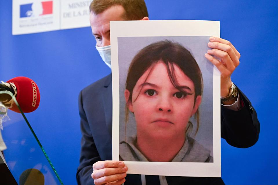 French public prosecutor Nicolas Heitz holds a portrait of missing child Mia Montemaggi during a press conference at The Epinal Courthouse in Epinal, eastern France on April 14, 2021, following a kidnapping alert which was was triggered for the eight year-old girl on April 13. - Epinal public prosecutor Nicolas Heitz stated that a kidnapping alert had been lifted but that
